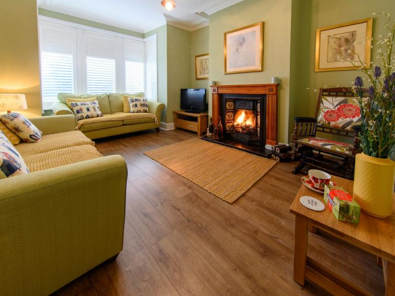 Relax in the lounge in front of the open fire