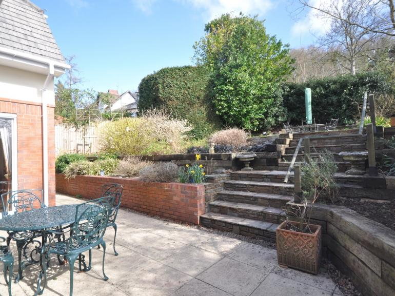 Enjoy the terraced gardens at this stylish family home