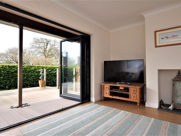 Open the bi-folding doors whilst relaxing in the evening