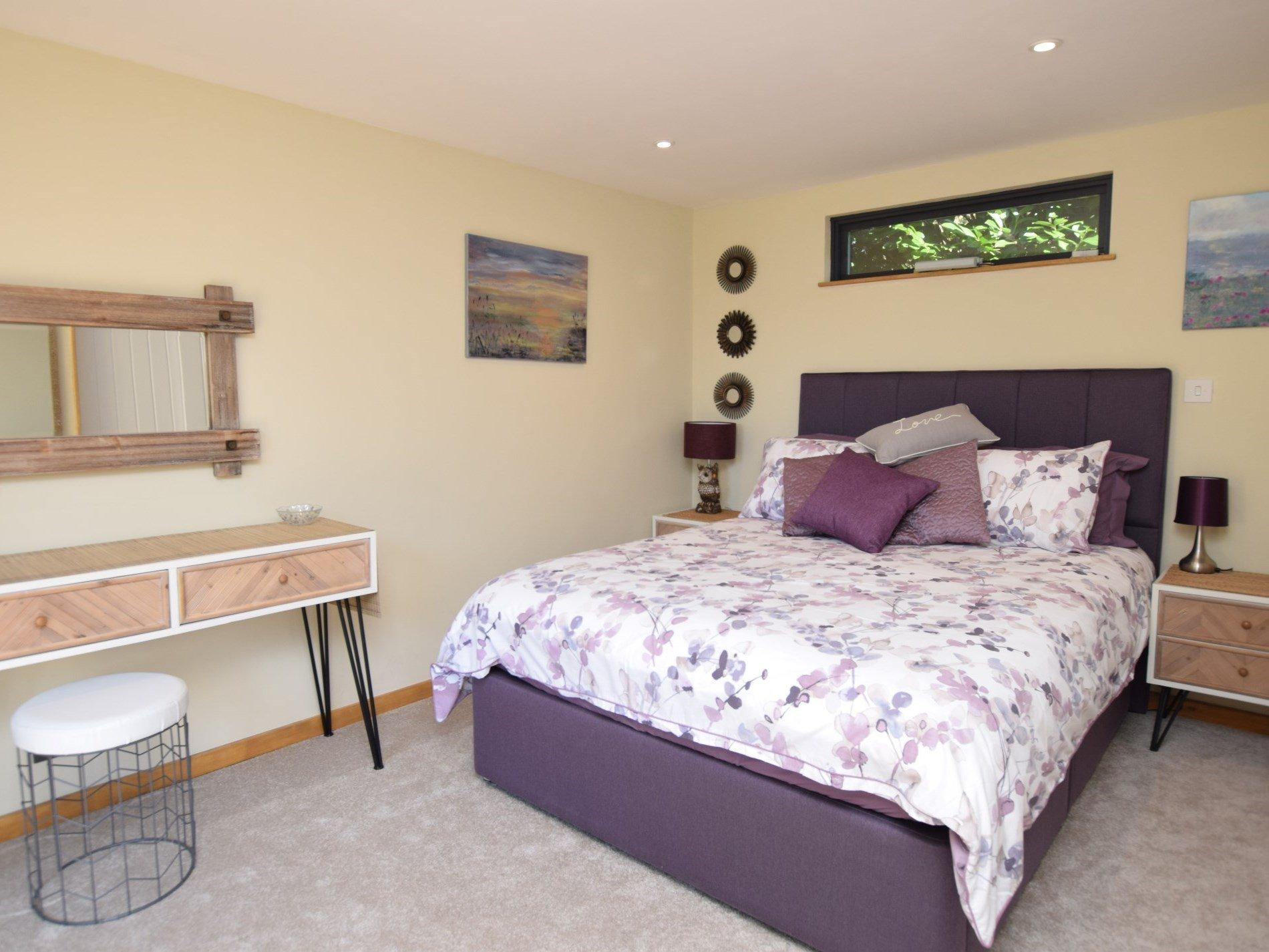 Retire to the pretty double bedroom