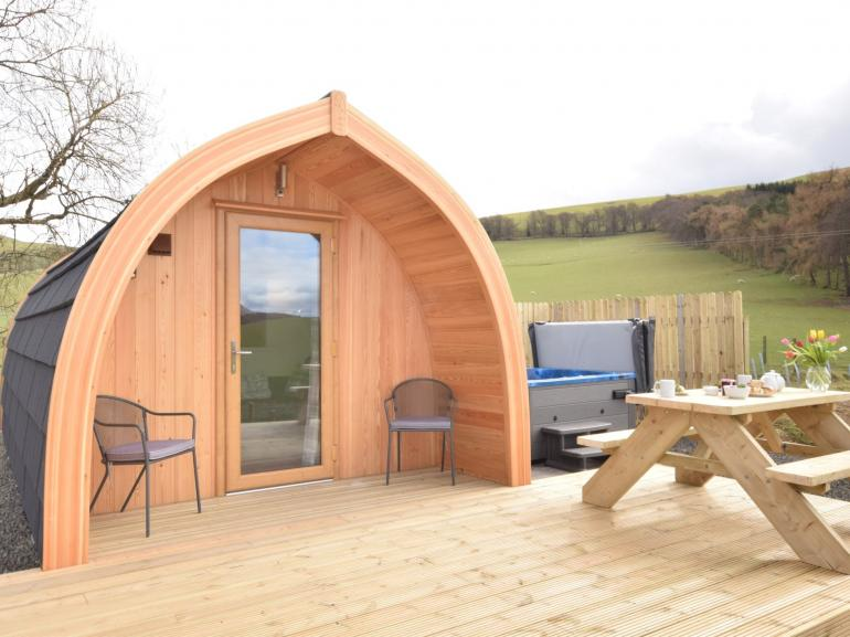 View towards this fantastic micro lodge with hot tub perfect for a romantic getaway