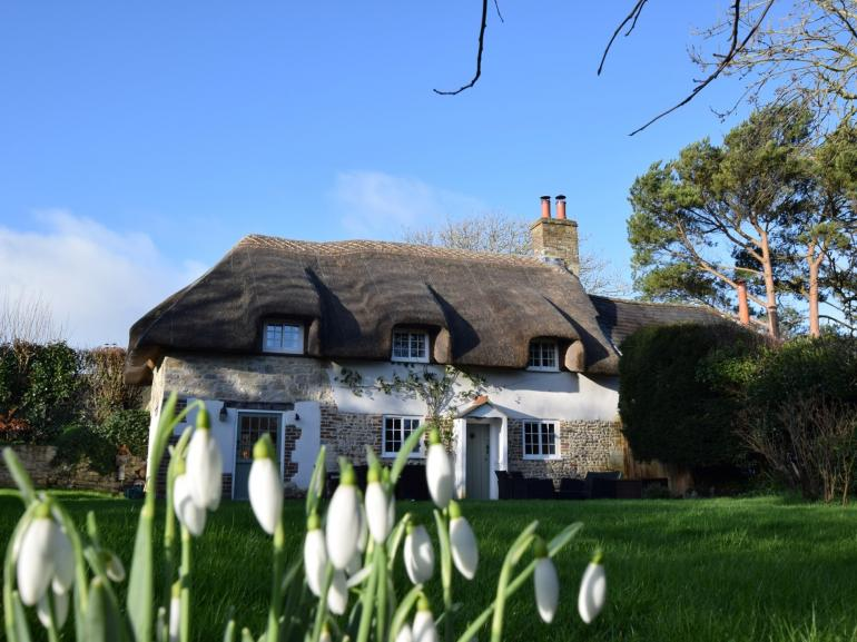 A warm welcome awaits at this traditional thatched cottage