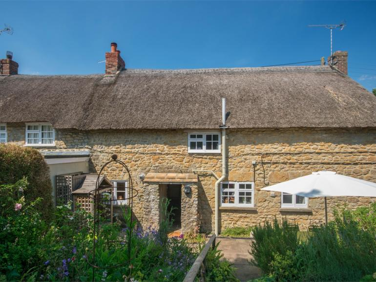 Looking towards the charming hamstone cottage from the garden
