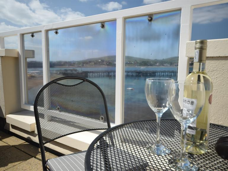 Unwind on the decking with a view across the bay