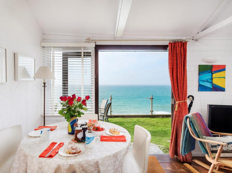 Open-plan living leading to the garden which boasts dazzling sea views
