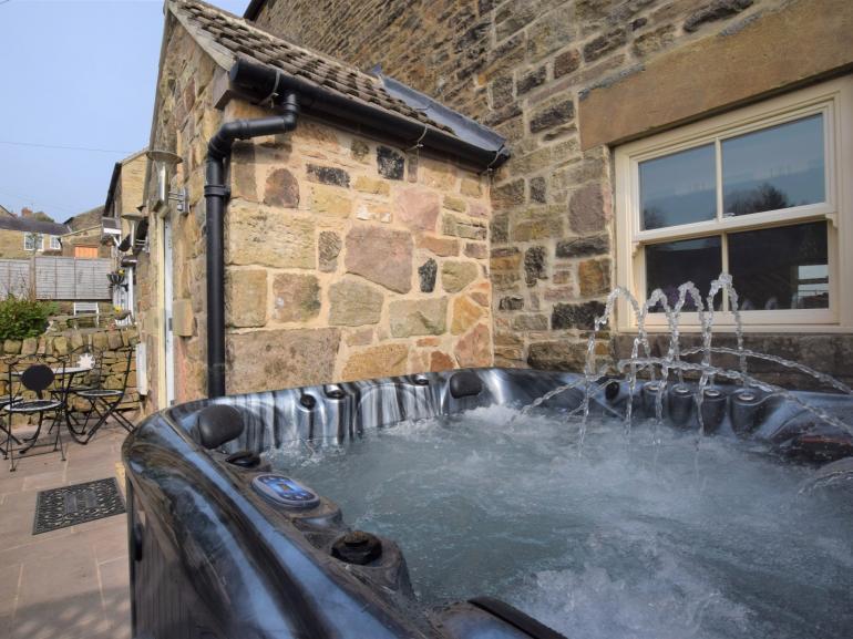 Enjoy a soak in the bubbling hot tub