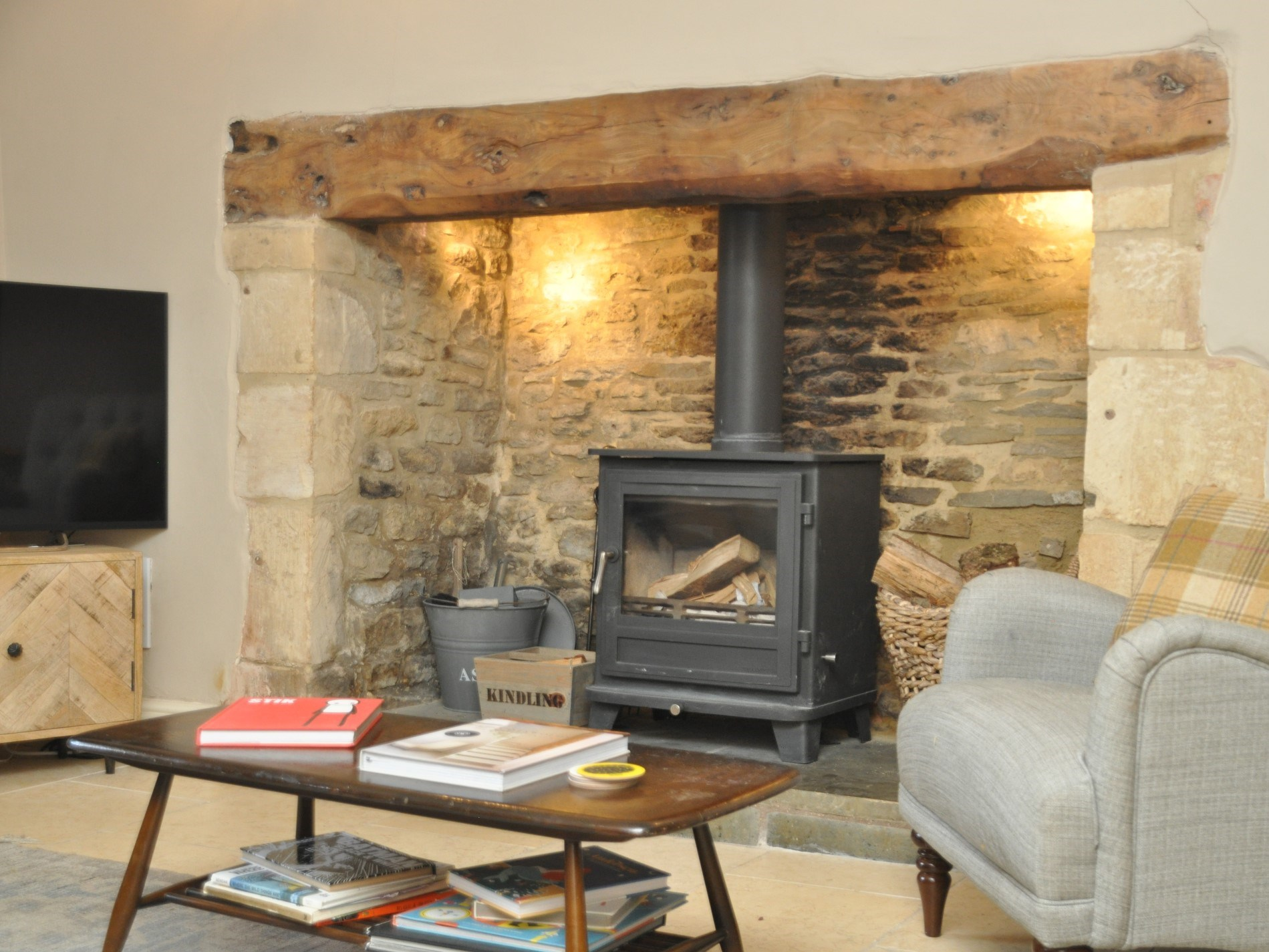 A wood burning stove compliments the ingle nook fire place