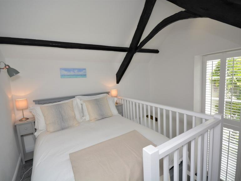 Head upstairs to the mezzanine level with double bed