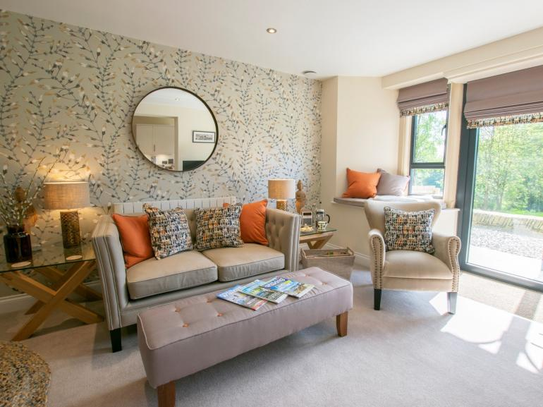 Relax in the open-plan lounge area with comfy chairs and sofa