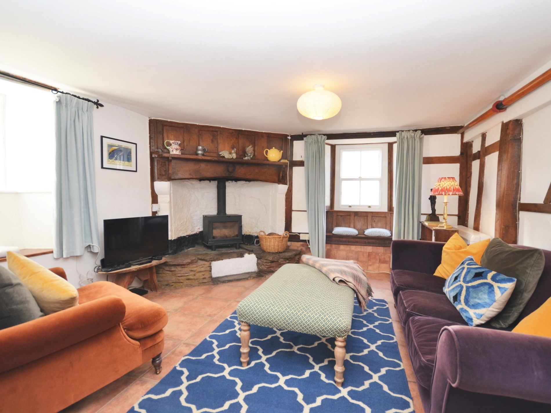 The lounge area is full of character features and has a warming wood burner