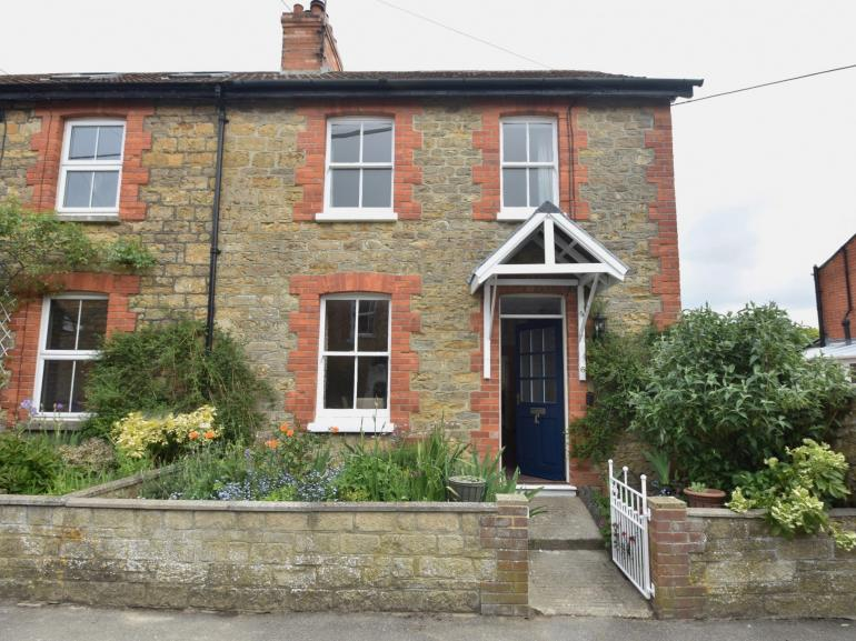 View towards the front of this pretty brick and flint cottage