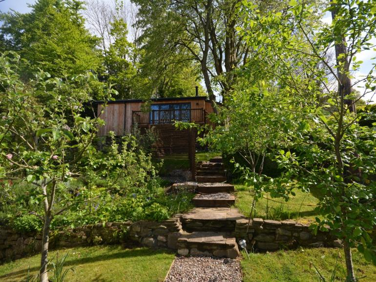 Tree-lined approach to your home away from home