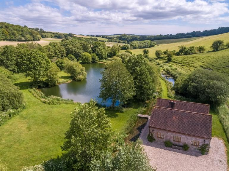 Relax and get away from it all at this peaceful lake side property