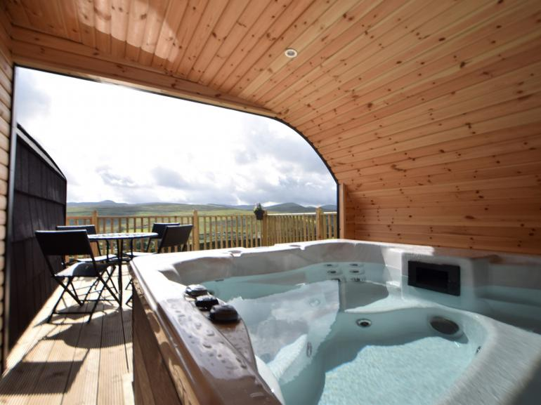 Open fronted, housed hot tub with wonderful views