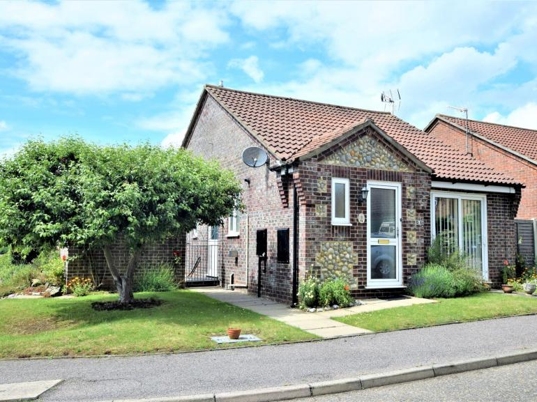 Brick and flint Norfolk bungalow in the coastal town