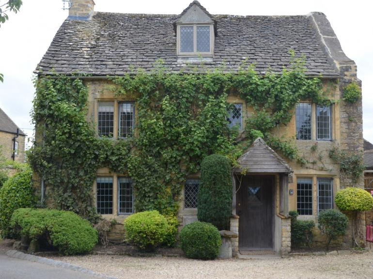 View towards the traditional Cotswolds stone cottage