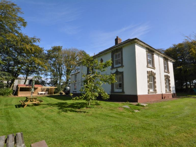 View towards this imposing period property, gardens and hot tub