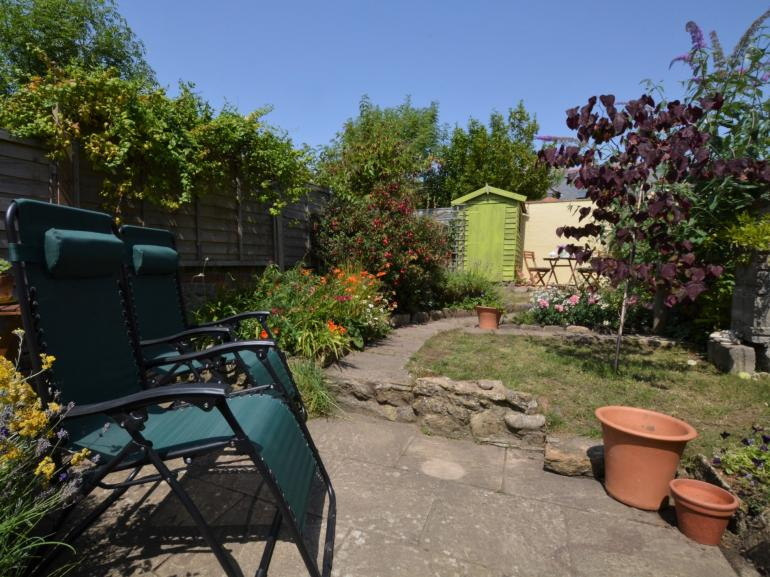 Relax in the pretty enclosed garden