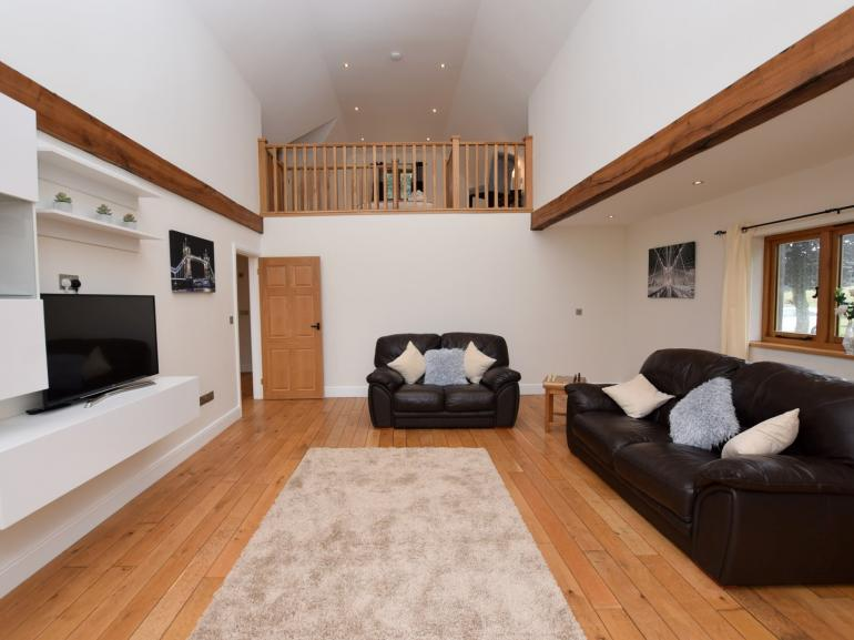 Spacious lounge with the master bedroom overlooking from the mezzanine