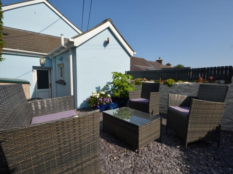 Sunny enclosed garden where you can relax and unwind with a glass of wine