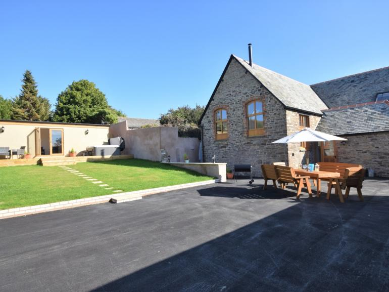 Looking towards the property with both games room and summer house