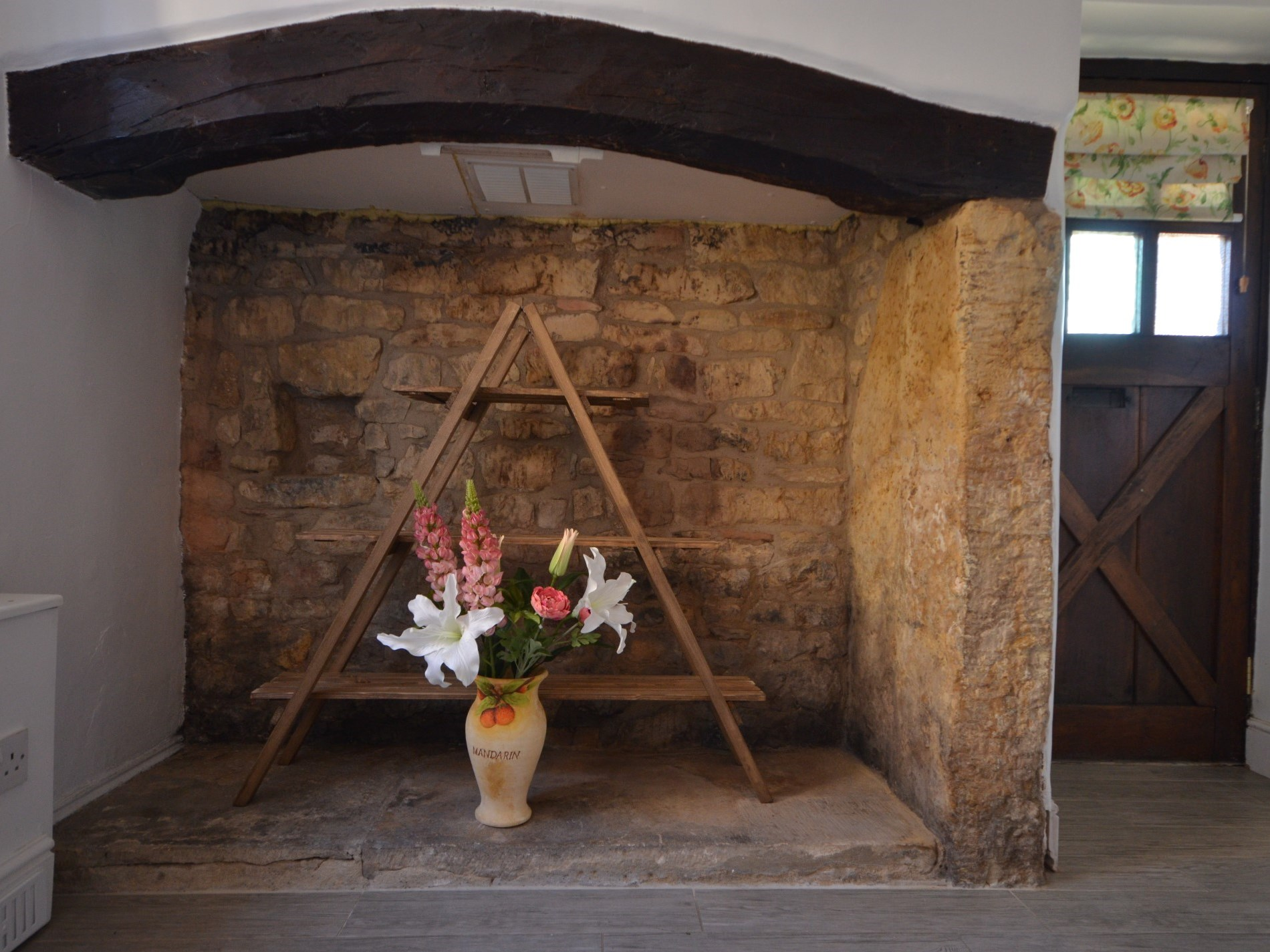 A traditional Cotswolds stone inglenook fireplace