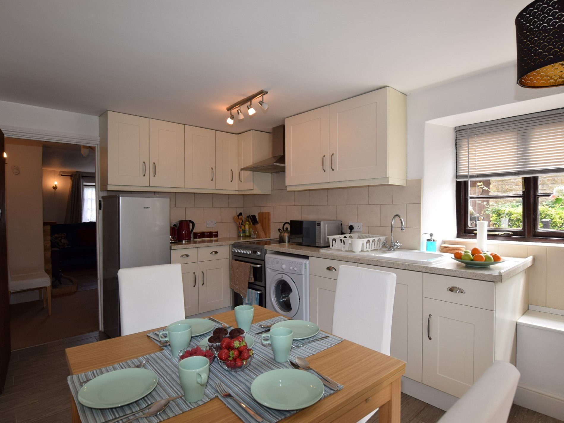 Kitchen and dining area with views onto the pretty cobbled street