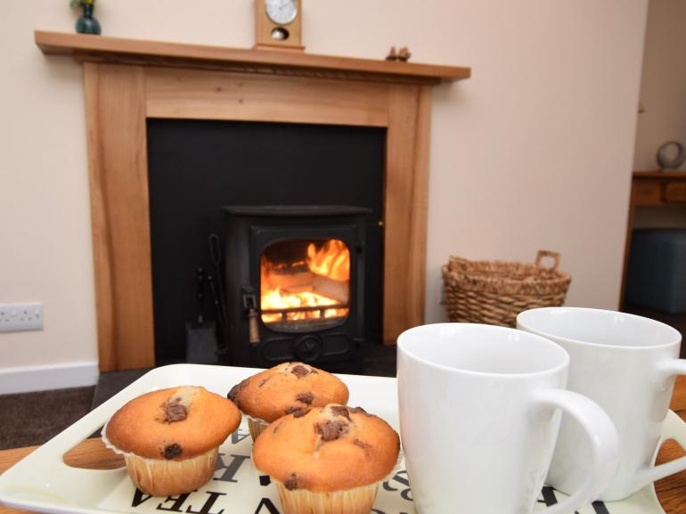 Cosy up by the warming wood burner