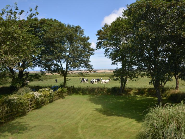 Superb views from your garden across to the coast