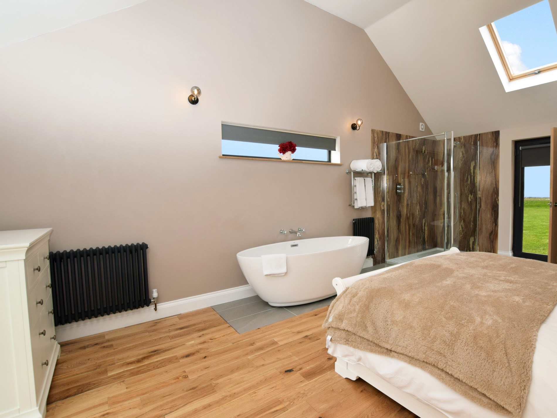 Spacious open plan bedroom and bathroom with separate WC