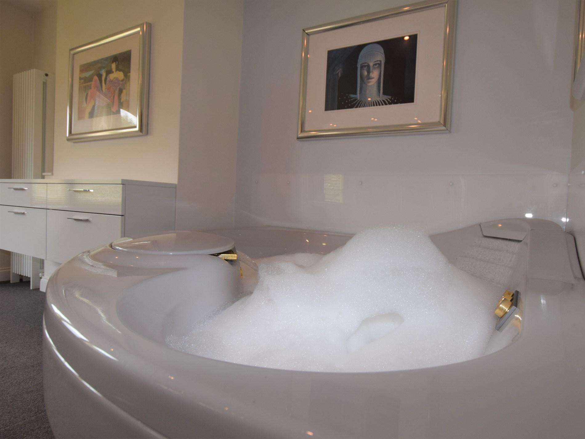 Take a long soak in the large spa bath