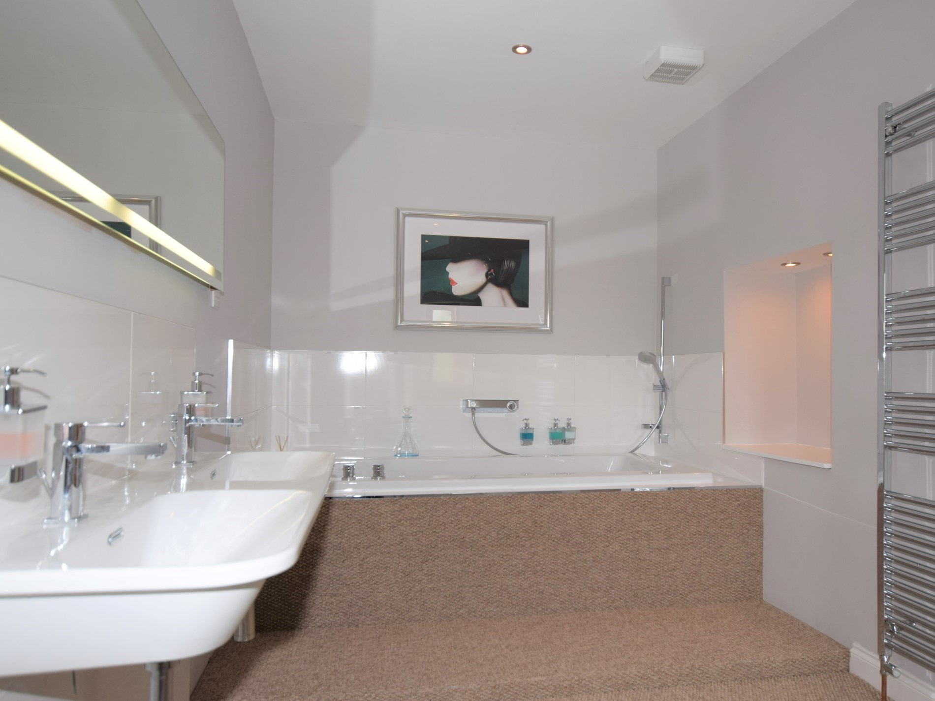 En-suite to master bedroom, twin sinks and a big bath to relax in