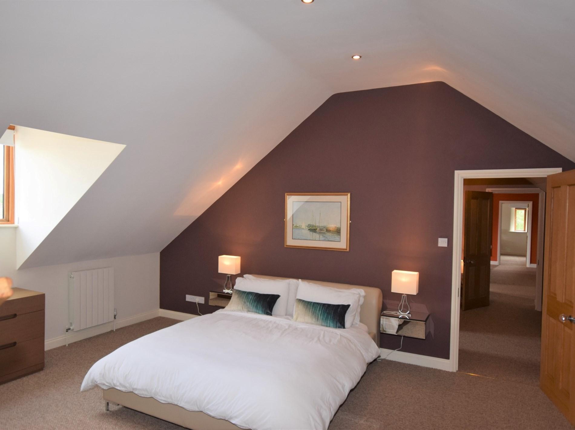 King-size bedroom with small snug next door