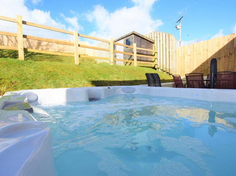 Relax and unwind in your very own private hot tub