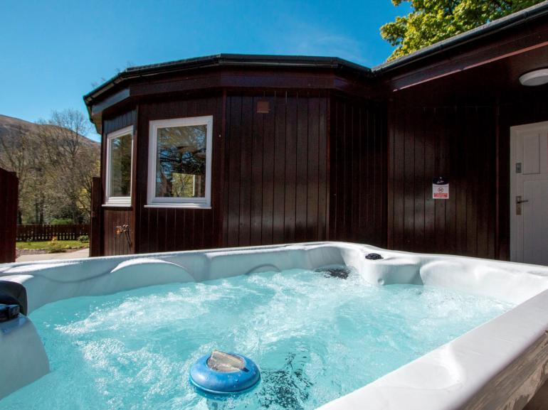 Relax in the hot tub with stunning views