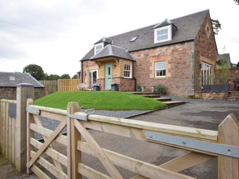 Views towards the property with fully enclosed garden and ample parking
