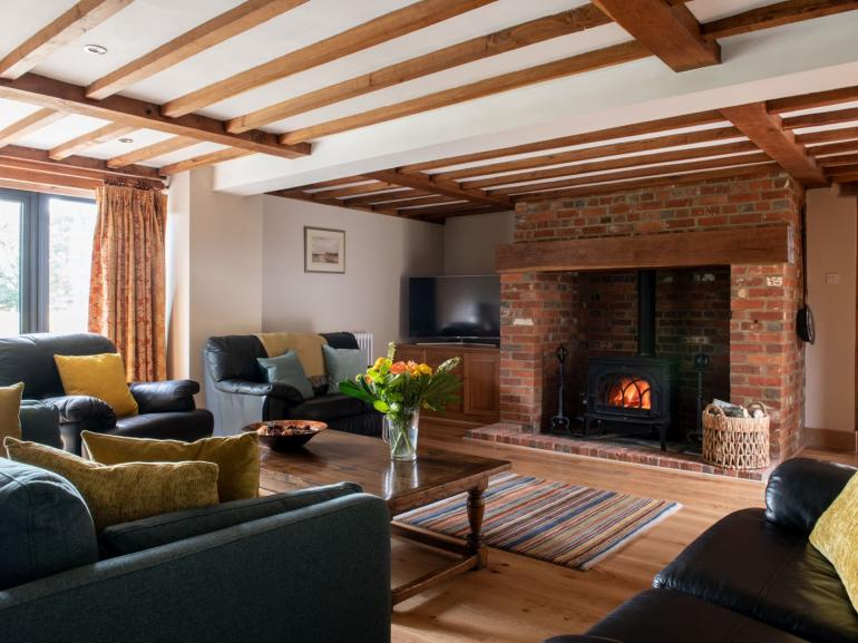 Unwind with family and friends in front of the roaring woodburner