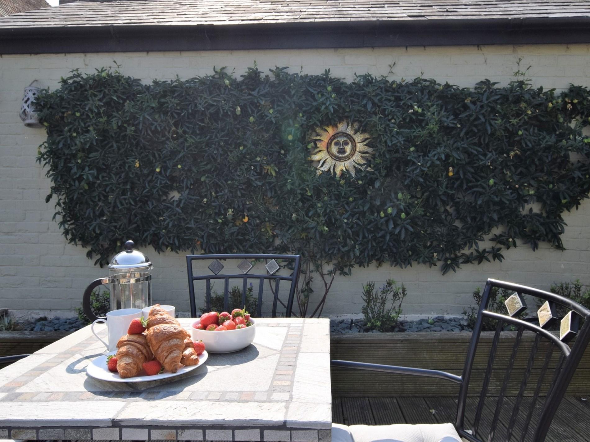 Enjoy breakfast in the fully enclosed garden