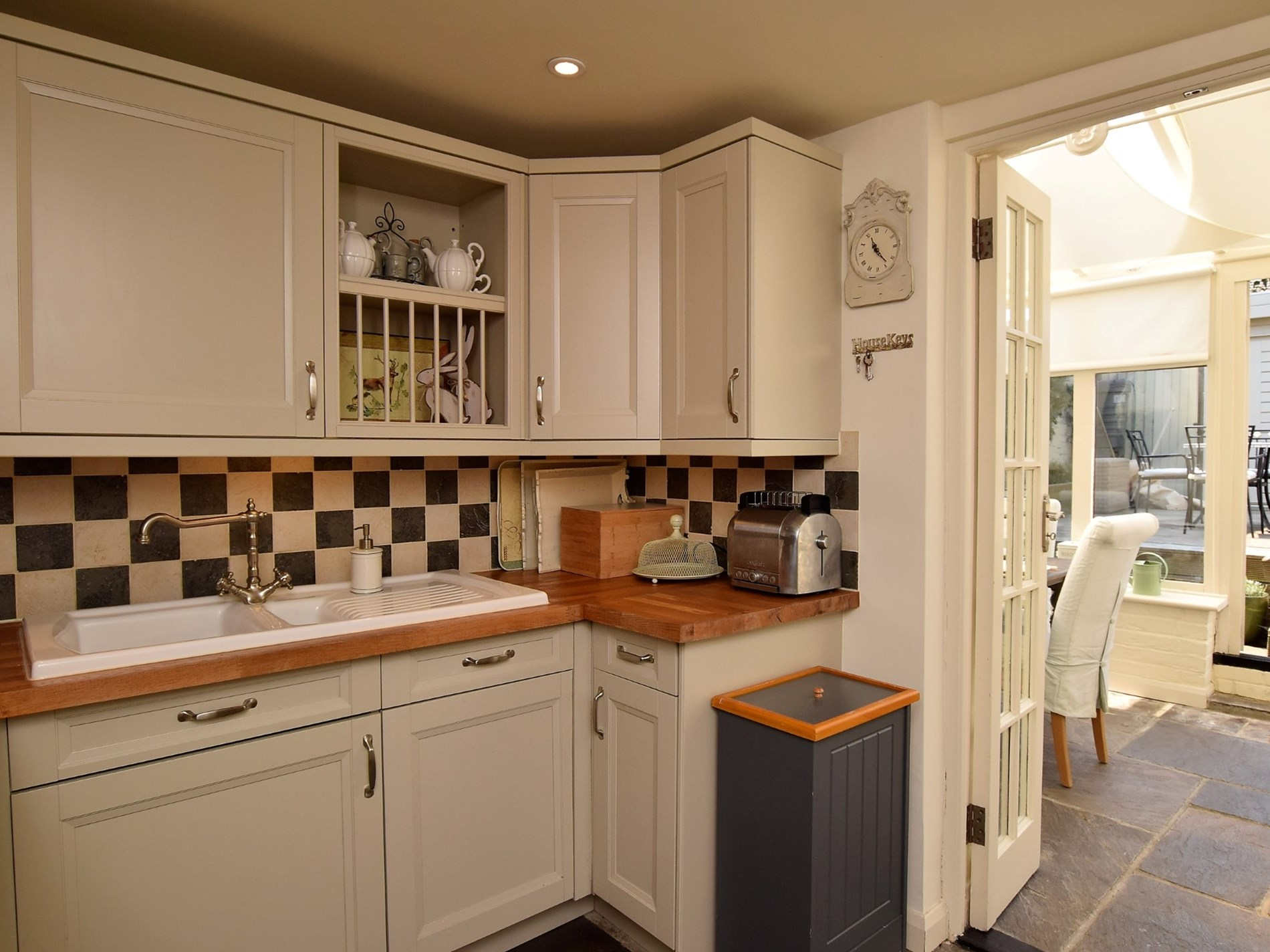 The kitchen leads out into the conservatory