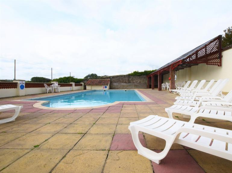 Enjoy a day by the solar heated outdoor swimming pool