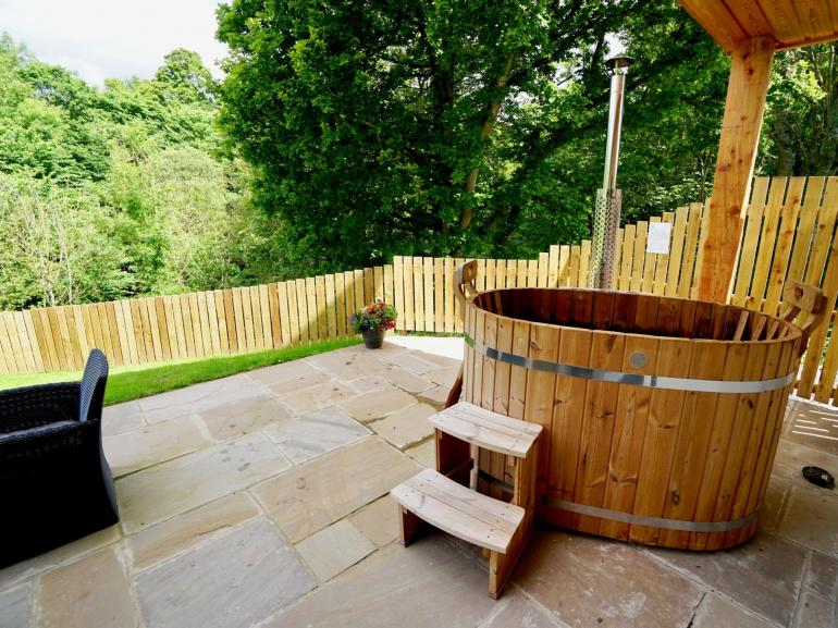 Relax in the fantastic wood-fired hot tub