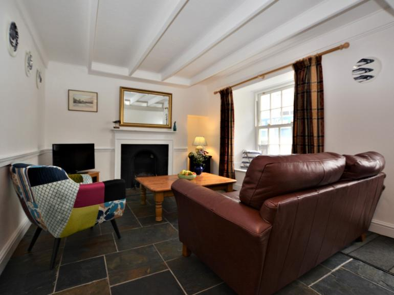 Cosy up and watch a film in front of the open fire