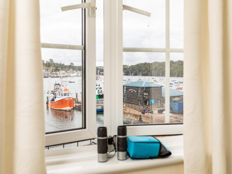 Relax and look out onto the river and working harbour