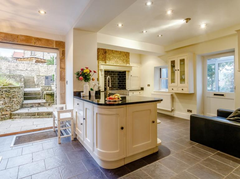The traditional styled kitchen is equipped with modern conveniences