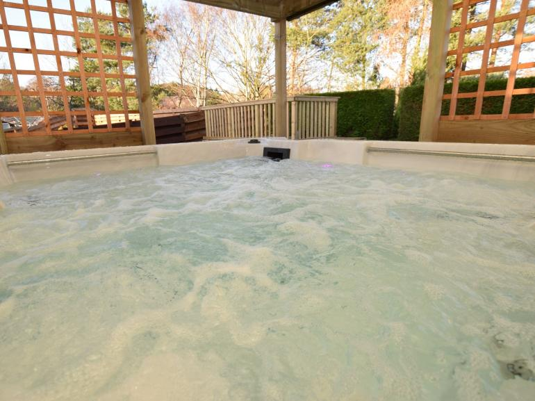 Relax and unwind in the private housed hot tub