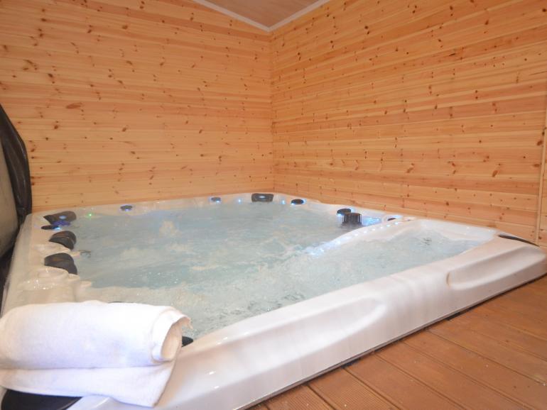 Large sunken hot tub seating 8 people
