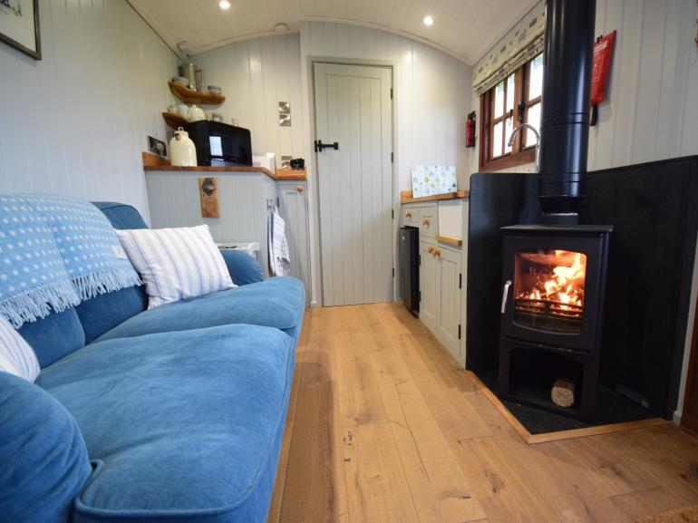 Curl up on the sofa in front of the wood burner