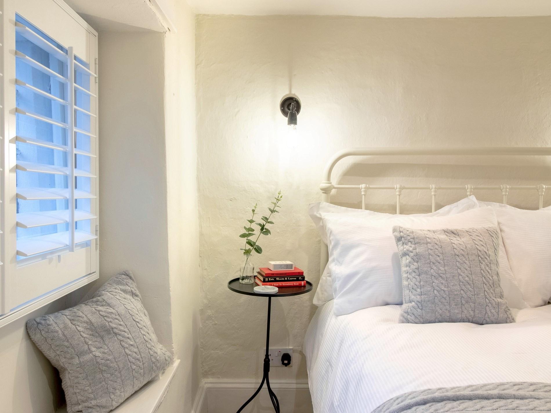Soft linen and wooden shutters
