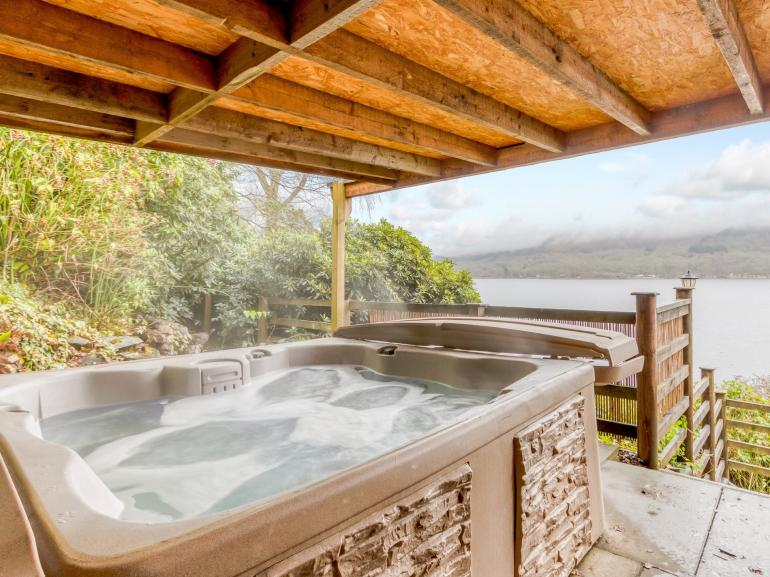 Relax in the hot tub and enjoy the views over Loch Earn