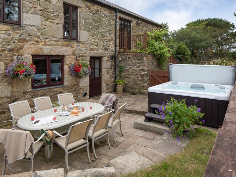 Enjoy lazing in the hot tub after an al fresco meal